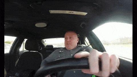 Gif de policía pillado cantando