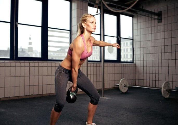 Chica haciendo Body Pump
